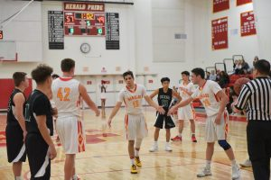 PHOTOS:  More great pictures of the Boys Varsity Basketball win over Brea