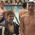 Middle School Swimmer takes down two records