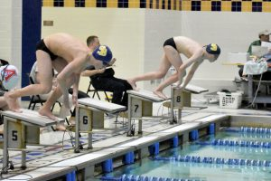 Boys swim against Adams