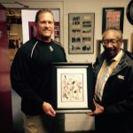 Willis Sanders Presents Drawing to Coach Marion for Tremendous First Season