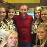 Cheerleaders promote Trojans vs. Falcons on Froggy Radio
