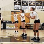 The Lady Wildcats are ready to receive the serve
