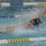 Boys Swimming: Schattenberg caps off FCPS/CMC championship day with a pair of titles and records.