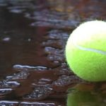 tennis ball in puddle