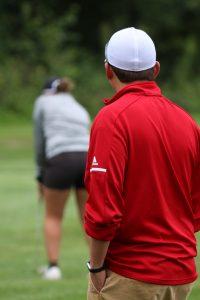 HS girl playing golf