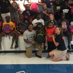 Greenwood High Football Donates Book bags