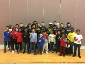 GHS Wrestlers Visit Woodfields Elementary and Read to Students