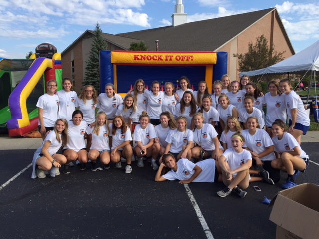 Girls Soccer team volunteers at TOP Soccer Fall Classic!