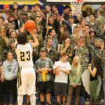 Hudsonville Basketball Survives in Double OT and Advances to District Finals