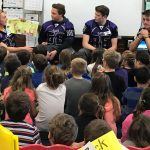 Wallen, Hartman, Rizzuto and McEahern reading to students