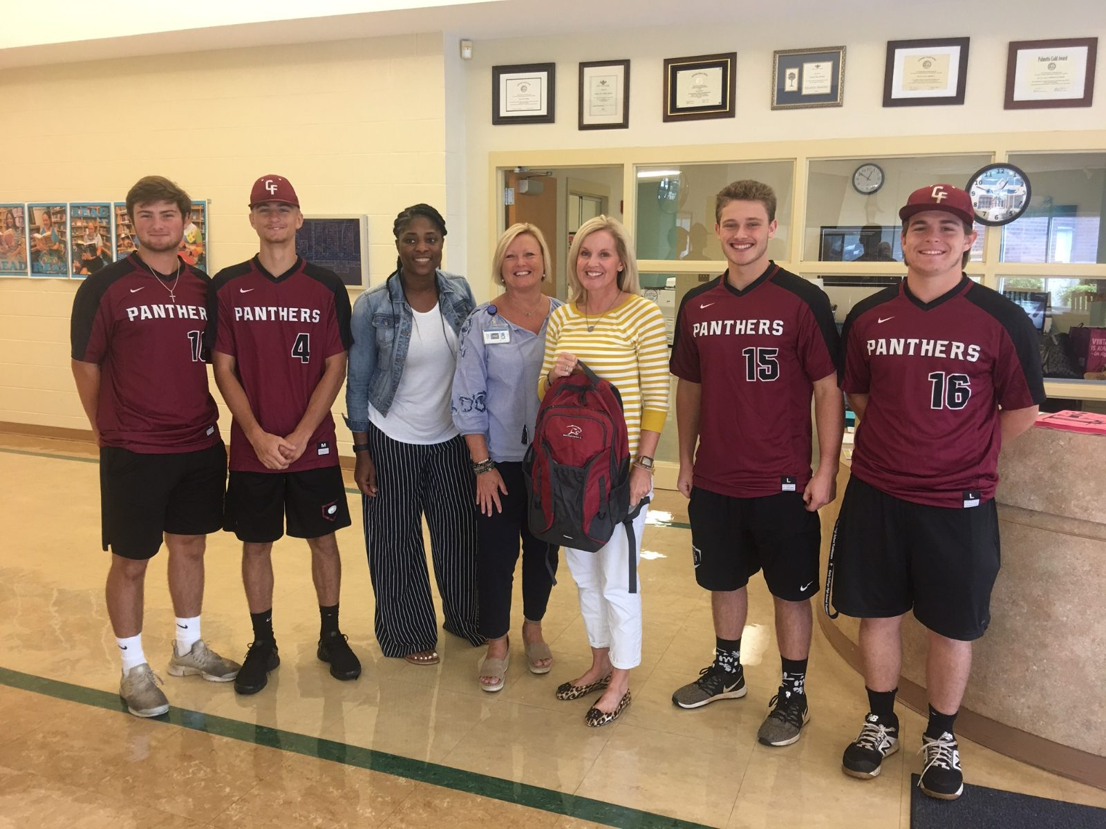 CFHS Baseball and Counselors Give Backpacks of School Supplies to Middle Schools