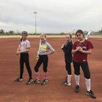 Four softball players.