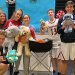 Group photo of students holding stuff animals.