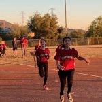 Softball players running.