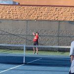 Tennis player hitting the ball.