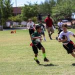 Flag football player running with the ball.