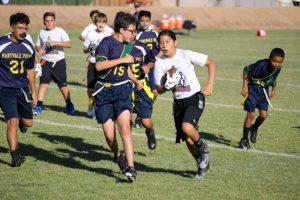 Flag football player running with ball.
