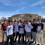 Boys basketball outside arena.