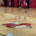 Boys playing basketball.
