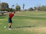 Male golf player tee shot