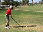 Male golfer tee shot
