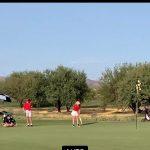 male and female golfer
