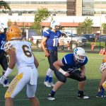 Football Falls to Rival Adams in Opener