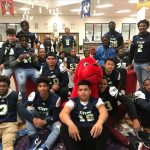Football Players Participate in Read Across America with Benefield ES Students