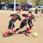 Soccer player dribbling the ball.