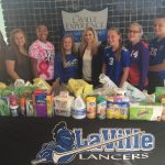 Softball Makes Donation To SB Center For The Homeless