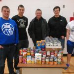 Basketball Makes Donation To Local Food Pantry
