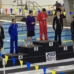 Denton High School swimmers Seth Herrmann and Zackery Clark on medal stand for 200 Free at UIL Region 2-5A Championships