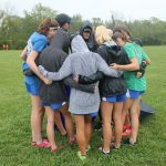 Girls Cross Country slides in the mud at Mason