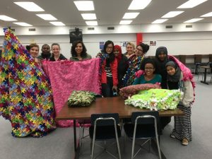 Apollo's National Honor Society and Care Club making Tie blankets for families in need.