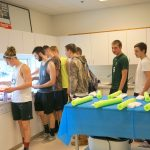Boys Volleyball Decorates Socks for Wold Down Syndrome Day