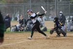 Softball wins a cold and windy wild one