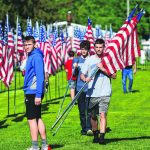 AN AVENUE OF RED, WHITE AND BLUE: Cemetery entrance fills with flags to honor Hancock County veterans – GDR: Mitchell Kirk
