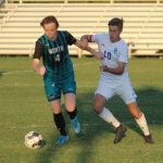 Late Push Earns Tie For Mustangs