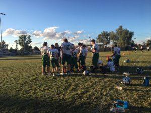 football team in huddle