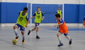 boys playing indoor soccer