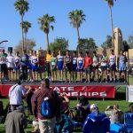 Cross country meet winners on stage