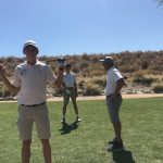 three boys with golf clubs