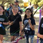 four girls with archery equipment