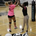 volleyball girl high fives coach