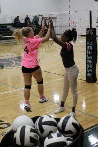 volleyball girl high fives coach