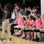 volleyball players cheer from sidelines