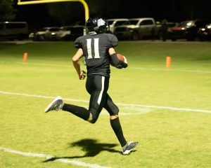 football player runs with ball