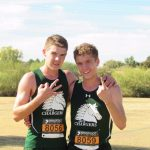 two track boys pose with hand signs