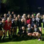 Group of soccer girls pose