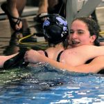 Swimming Sweeps Districts, Abbott named COY